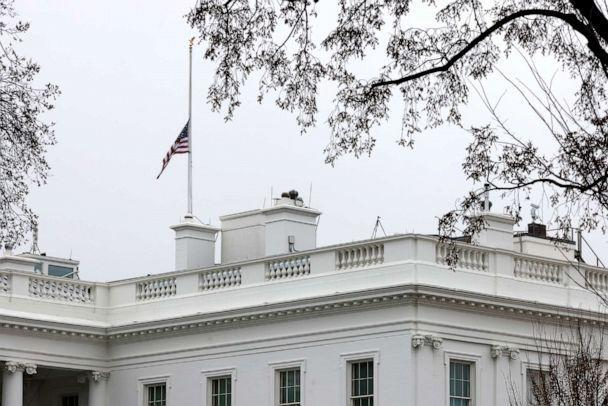 PHOTO: The American flag atop the White House is lowered to half-staff in honor of those killed in a string of attacks in Atlanta area spas, March 18, 2021. (Carlos Barria/Reuters)