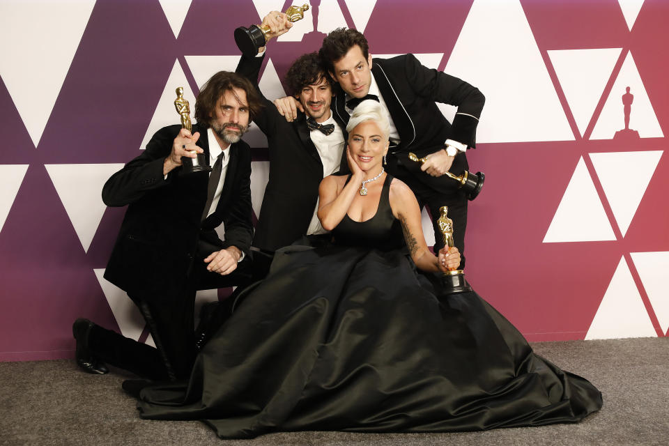 """HOLLYWOOD, CALIFORNIA - FEBRUARY 24: Lady Gaga, Mark Ronson, Anthony Rossomando, Andrew Wyatt (Best Original Song: """"Shallow"""" - A Star Is Born) pose in the press room at the 91st Annual Academy Awards at the Dolby Theatre in Hollywood, California on February 24, 2019. (Photo credit should read John Rasimus / Barcroft Media via Getty Images)"""