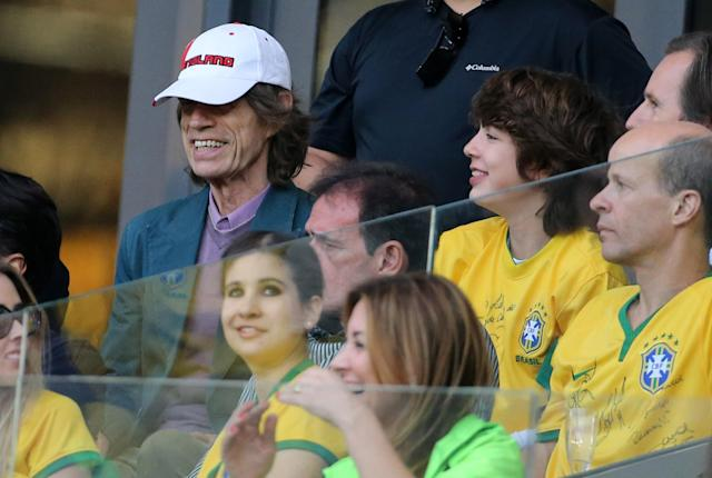 Mick Jagger and his last son Lucas Jagger attend the 2014 FIFA World Cup Brazil Semi Final match between Brazil and Germany at Estadio Mineirao on July 8, 2014 in Belo Horizonte, Brazil. (Getty Images)