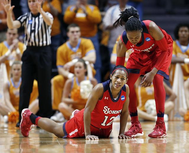 St. John's guard Briana Brown (12) is helped up by Amber Thompson in the second half of an NCAA women's college basketball second-round tournament game against Tennessee Monday, March 24, 2014, in Knoxville, Tenn. Tennessee won 67-51. (AP Photo/John Bazemore)