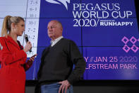 Race horse Omaha Beach's trainer Richard Mandella, right, is interviewed by racing analyst Acacia Courtney during the draw for the Pegasus World Cup Horse Race, Wednesday, Jan. 22, 2020, in Hallandale Beach, Fla. The race will run Saturday, Jan. 25 at Gulfstream Park in Hallandale Beach. (AP Photo/Wilfredo Lee)