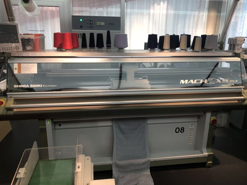 A general view of garment-to-garment recycling machine in a H&M store in Stockholm