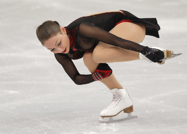 Elene Gedevanishvili of Georgia competes in the women's short program figure skating competition at the Iceberg Skating Palace during the 2014 Winter Olympics, Wednesday, Feb. 19, 2014, in Sochi, Russia. (AP Photo/Vadim Ghirda)