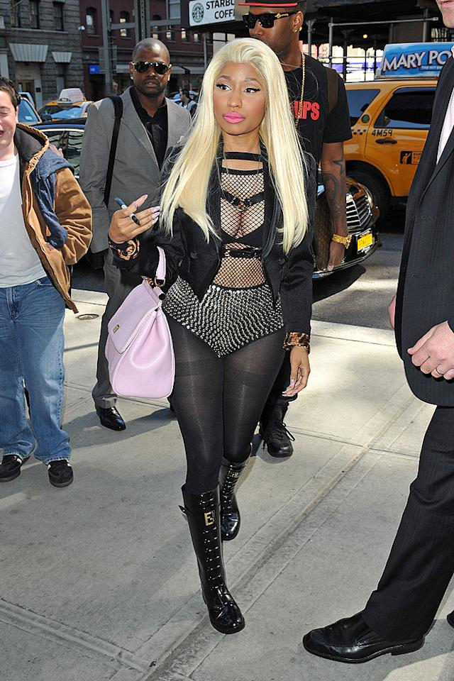 "Once again, Nicki Minaj tortured the innocent residents of NYC by stepping out in one of her signature ensembles. Will the ""Starships"" songstress ever learn that these garish getups -- especially ones that feature fishnet tops and studded hot pants -- take the focus off of her blossoming music career and put the spotlight on her lack of sophistication? (4/6/2012)"