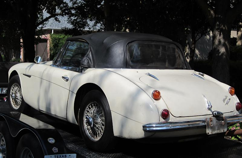 In this image provided by the Los Angeles County Sheriff's Department the stolen car sits on small transport trailer as it is delivered to Robert Russell 's home in Texas. Russell whose prized 1967 Austin Healy sports car was stolen 42 years ago, recovered the vehicle after spotting it on eBay, authorities said Sunday July 15, 2012. (AP Photo/Los Angeles County Sheriff's Department)