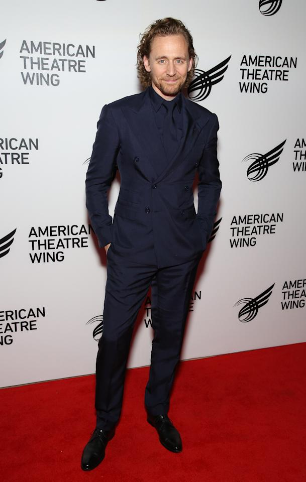 <p>WHERE: American Theatre Wing's 2019 Gala in New York</p> <p>WHEN: September 16, 2019</p> <p>WHY: Tom Hiddleston is kicking off plenty of 1993 energy with this triangle of a suit, this garlic knot of a tie, and those gelled curls.</p>