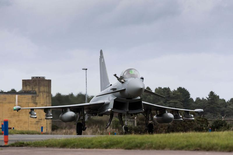 A Eurofighter Typhoon landing at Leuchars Station after returning from a Quick Reaction Alert to intercept two Russian aircraft off the Scottish Coast (PA)