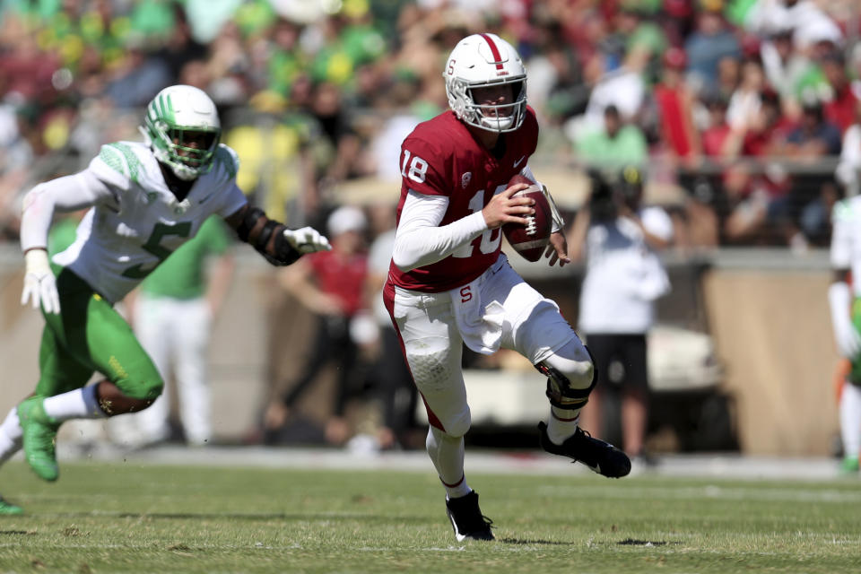 Stanford's Tanner McKee runs with the ball against Oregon during the first half of an NCAA college football game in Stanford, Calif., Saturday, Oct. 2, 2021. (AP Photo/Jed Jacobsohn)