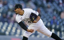 Colorado Rockies starting pitcher Antonio Senzatela works agaimst the Arizona Diamondbacks during the first inning of a baseball game Wednesday, April 7, 2021, in Denver. (AP Photo/David Zalubowski)