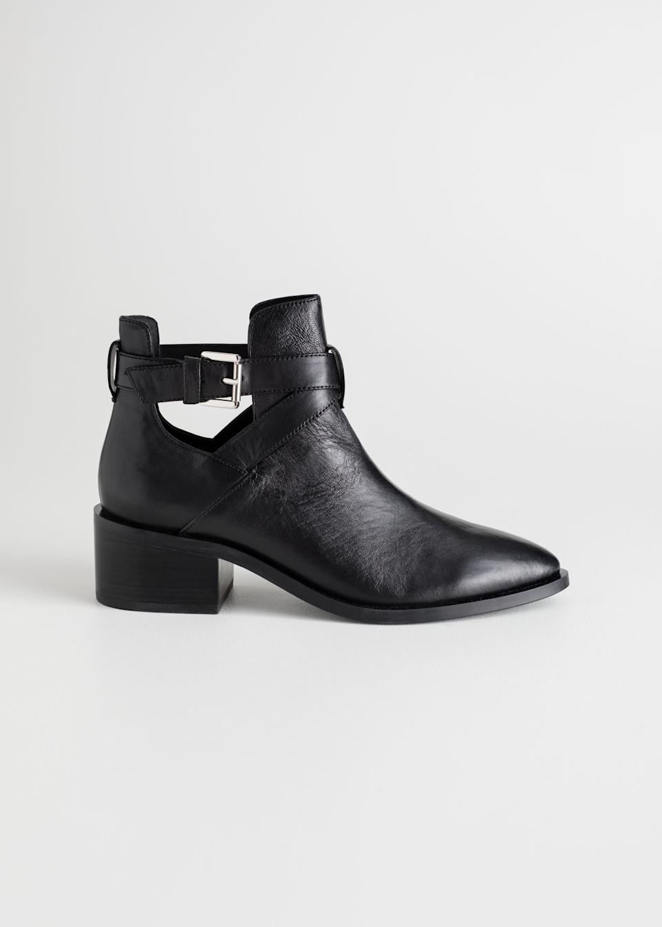 "<br><br><strong>& Other Stories</strong> Cut Out Leather Ankle Boots, $, available at <a href=""https://go.skimresources.com/?id=30283X879131&url=https%3A%2F%2Fwww.stories.com%2Fen_usd%2Fshoes%2Fboots%2Fankleboots%2Fproduct.cut-out-leather-ankle-boots-black.0399291001.html"" rel=""nofollow noopener"" target=""_blank"" data-ylk=""slk:& Other Stories"" class=""link rapid-noclick-resp"">& Other Stories</a>"