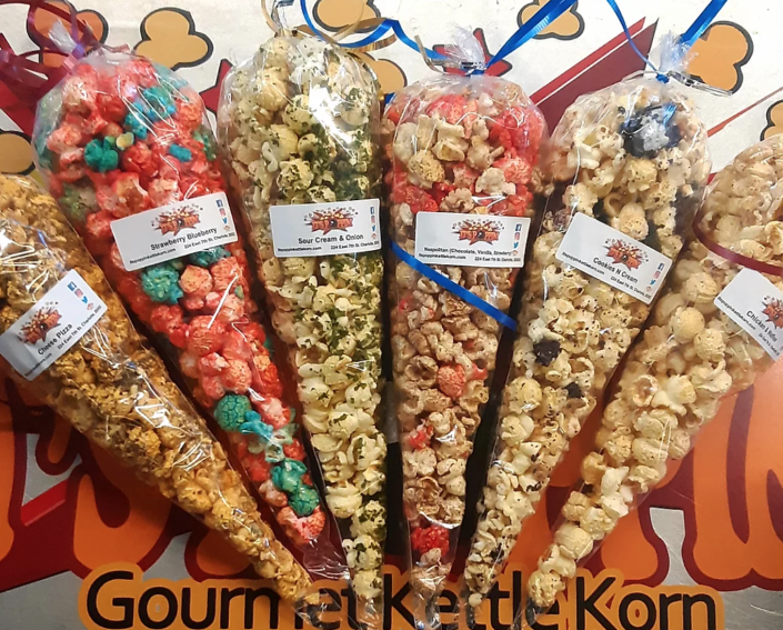"""<p><strong>Kettle Korn Kones, 10-pack</strong></p><p>itspoppingourmetkettlekorn.com</p><p><strong>$25.00</strong></p><p><a href=""""https://www.itspoppingourmetkettlekorn.com/product-page/kettle-korn-kones-1"""" rel=""""nofollow noopener"""" target=""""_blank"""" data-ylk=""""slk:BUY NOW"""" class=""""link rapid-noclick-resp"""">BUY NOW</a></p><p>As Charlotte, NC, transplant, I would be remiss not to mention at least one Charlotte-based black-owned business. <a href=""""https://www.itspoppingourmetkettlekorn.com/"""" rel=""""nofollow noopener"""" target=""""_blank"""" data-ylk=""""slk:It's Poppin' Gourmet Kettle Korn"""" class=""""link rapid-noclick-resp"""">It's Poppin' Gourmet Kettle Korn</a> operates in the popular 7th Street Market in Uptown, selling popcorn with flavors you don't hear every day: hot wings, toffee, jelly donuts, and their signature <a href=""""https://www.itspoppingourmetkettlekorn.com/product-page/fried-chicken-kettle-korn"""" rel=""""nofollow noopener"""" target=""""_blank"""" data-ylk=""""slk:fried chicken kettle korn"""" class=""""link rapid-noclick-resp"""">fried chicken kettle korn</a>. <a href=""""https://www.itspoppingourmetkettlekorn.com/shop"""" rel=""""nofollow noopener"""" target=""""_blank"""" data-ylk=""""slk:Order online"""" class=""""link rapid-noclick-resp"""">Order online</a> and select from a range of sizes, in case you don't want to commit to a full tub of hot wing popcorn on the first try.</p>"""