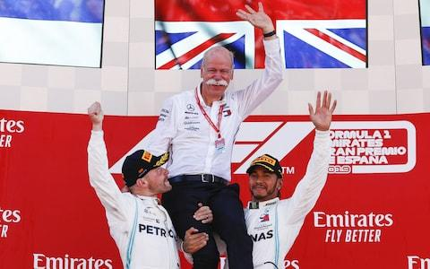 Dieter Zetsche smiles with Lewis Hamilton of Mercedes AMG Petronas Formula One Team and Valtteri Bottas of Mercedes AMG Petronas Formula One Team during the F1 Grand Prix of Spain at Circuit de Barcelona-Catalunya on May 12, 2019 in Barcelona, Spai - Credit: Getty Images