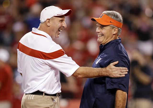 Nebraska head coach Bo Pelini, left, chats with Illinois head coach Tim Beckman before an NCAA college football game in Lincoln, Neb., Saturday, Sept. 27, 2014. (AP Photo/Nati Harnik)