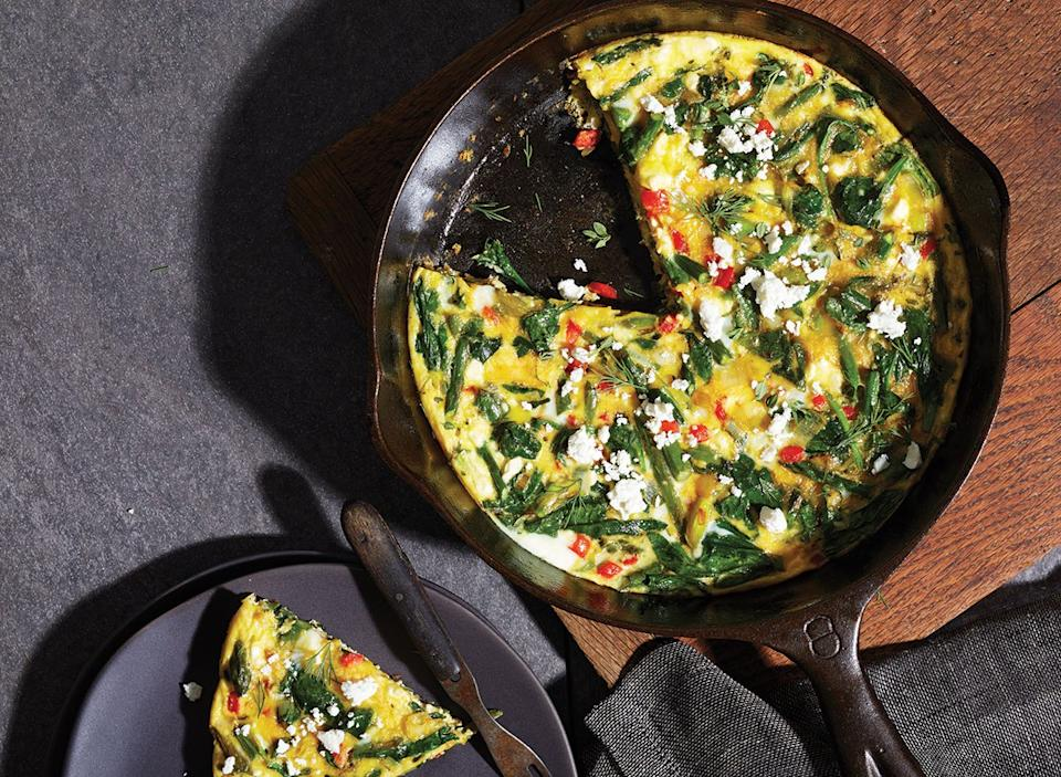 spring vegetable frittata in black cast iron skillet