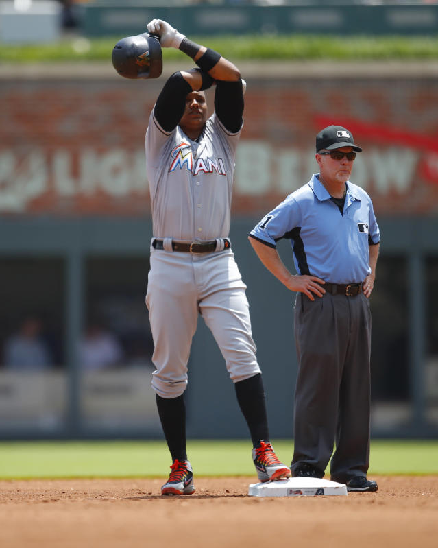 Miami Marlins Starlin Castro reacts after hitting a double in the fourth inning of a baseball game against the Atlanta Braves, Sunday, May 20, 2018, in Atlanta. (AP Photo/Todd Kirkland)