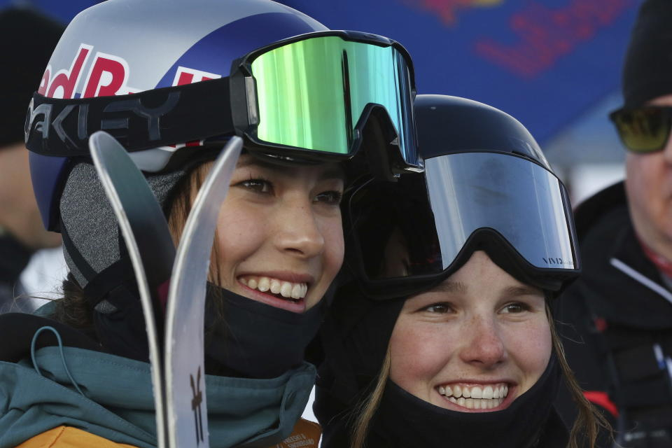FILE - In this Feb. 15, 2020 file photo, Eileen Gu, left, of China, gold medal winner and Megan Oldham, of Canada, bronze winner, celebrate after the women's slopestyle at a World Cup freestyle skiing event in Calgary, Alberta, Canada. Gu, who hails from San Francisco but has roots in China, broke through Friday, Jan. 29, 2021 to become a Winter X-Games champion on the halfpipe. Next February, she will be on the short list of gold-medal contenders at the Beijing Olympics. (Dave Chidley/The Canadian Press via AP, File)