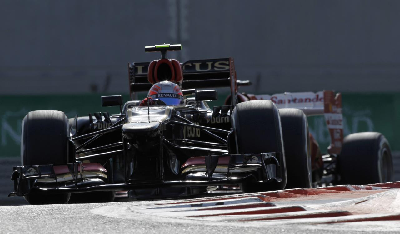 Lotus F1 Formula One driver Romain Grosjean of France takes a corner during the third practice session of the Abu Dhabi F1 Grand Prix at the Yas Marina circuit on Yas Island, November 2, 2013. REUTERS/Caren Firouz (UNITED ARAB EMIRATES - Tags: SPORT MOTORSPORT F1)
