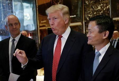 U.S. President-elect Donald Trump and Alibaba Executive Chairman Jack Ma speak with members of the news media after their meeting at Trump Tower in New York, U.S., January 9, 2017.   REUTERS/Mike Segar