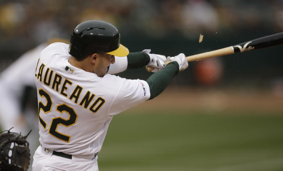 Oakland Athletics' Ramon Laureano swings for a two-run single off Seattle Mariners' Gerson Bautista in the first inning of a baseball game Saturday, June 15, 2019, in Oakland, Calif. (AP Photo/Ben Margot)