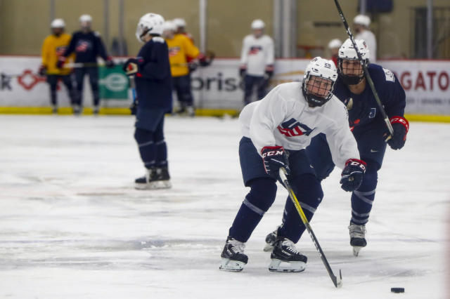 """In this photo taken Monday, Nov. 4, 2019, Kendall Coyne-Schofield, center, a member of the U.S. Women's National hockey team, goes through drills during their practice in Cranberry Township, Butler County, Pa. While the WNBA continues to grow and women's professional soccer is capitalizing off a World Cup bump, women's hockey remains at a standstill with top players opting not to play professionally in North America in hopes of eventually creating a sustainable league with salaries that allow them to focus on their game and not just getting by. """"For me, my clock is ticking,"""" Schofield said. """"But if I can leave this game better than it was, that's what's most important."""" (AP Photo/Keith Srakocic)"""