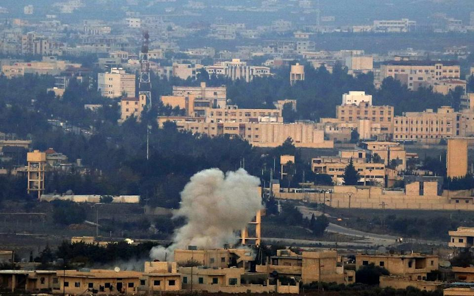 A picture taken on November 18, 2014 from the Israeli-annexed Golan Heights near the Quneitra border crossing with Israel shows smoke billowing from buildings in Syrian territory (AFP Photo/Jalaa Marey)