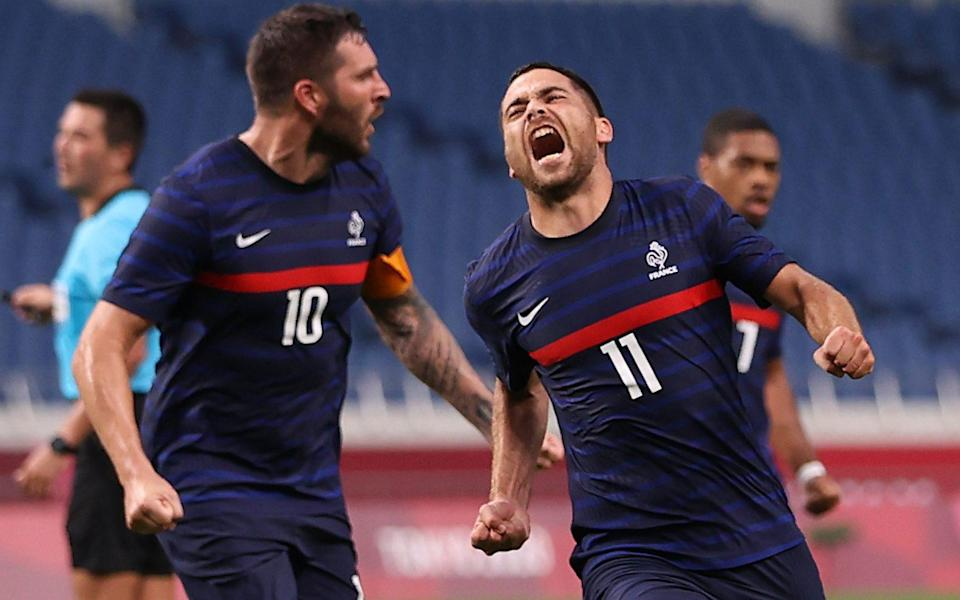 Teji Savanier of France celebrates scoring their fourth goal with Andre-Pierre Gignac of France - REUTERS/Molly Darlington