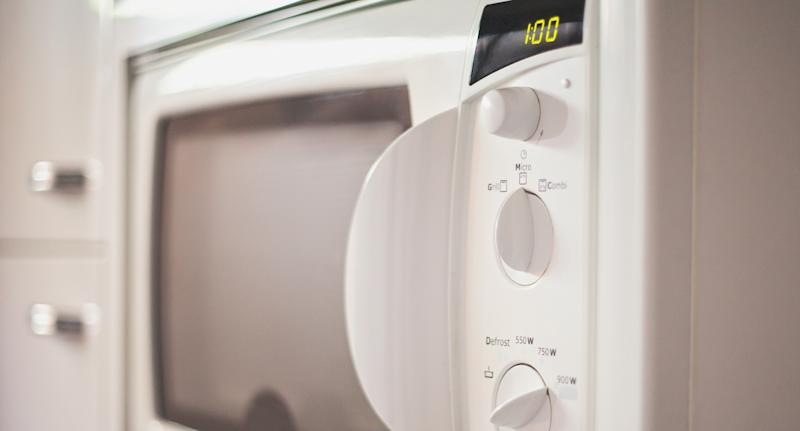 Photo shows a microwave with a one minute timing.