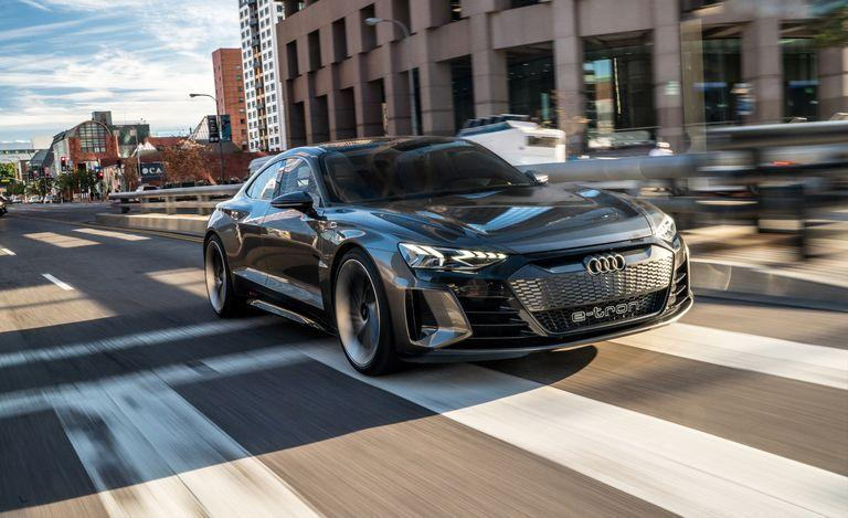 "<p>Audi's electric e-tron lineup grows for 2021, with <a href=""https://www.caranddriver.com/reviews/a25577091/audi-e-tron-gt-concept-drive/"" target=""_blank"">the shapely GT</a> joining today's e-tron (no name, just e-tron) crossover. There's no dancing around it: <a href=""https://www.caranddriver.com/audi/e-tron-gt"" target=""_blank"">the GT</a> is aimed squarely at Tesla's Model S. Audi is hoping it will deliver more than 250 miles of driving range and nearly 600 horsepower from a pair of electric motors (one per axle). Underneath its <em>Blade Runner </em>exterior hides the same J1 architecture developed for fellow Volkswagen Group member Porsche, for its Taycan EV.</p>"