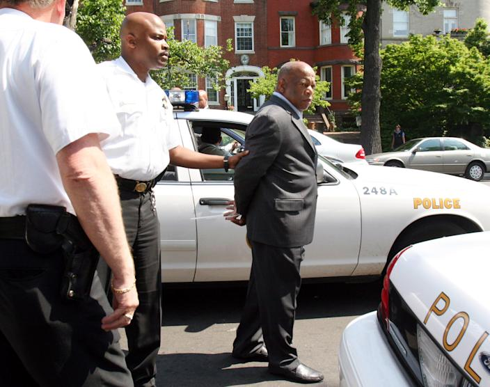 Congressional Black Caucus members, including Rep. John Lewis, D-Ga., right, were arrested after a news conference regarding Darfur on May 16, 2006, at the Sudanese Embassy in Washington. They were arrested by Secret Service Uniform Division officers for blocking the entrance of the embassy. (Photo: Lauren Victoria Burke/AP)
