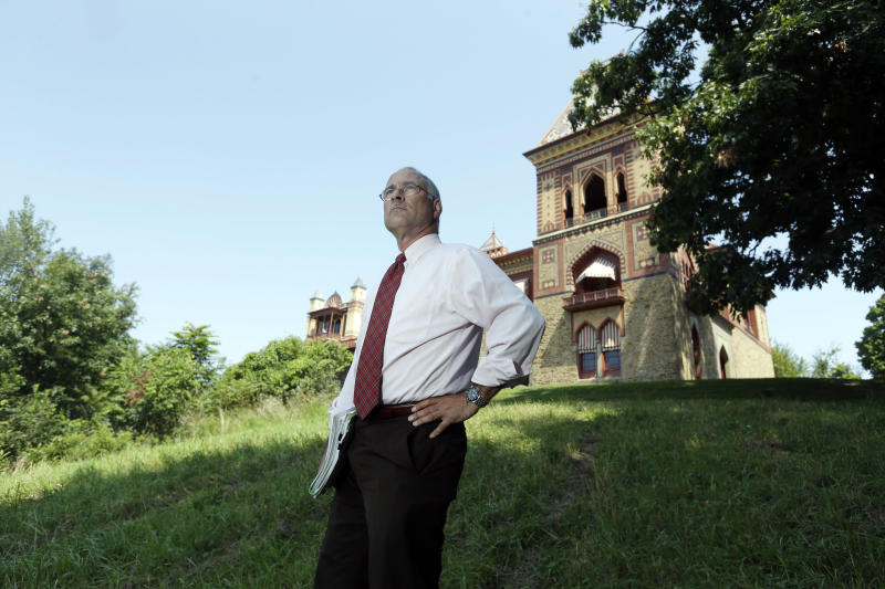 In this Wednesday, Aug. 21, 2013, photo, Jeffrey Anzevino poses on the grounds of the Olana State Historic Site in Greenport, N.Y. Anzevino is the director of land use advocacy for Scenic Hudson. (AP Photo/Mike Groll)