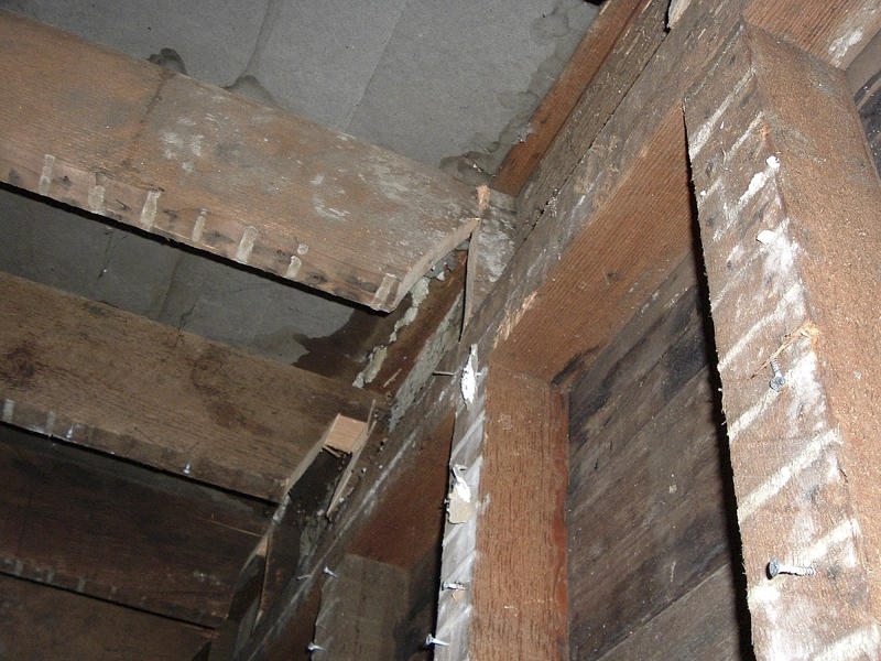 "This undated photo released by the San Francisco Office of the District Attorney shows cut joists under the floor of a San Francisco apartment. A couple prosecutors dubbed the ""landlords from hell"" for going to scary lengths to drive tenants from a San Francisco apartment building has pleaded guilty to several felonies. Prosecutors said Wednesday that 37-year-old Nicole Macy and 38-year-old Kip Macy threatened to shoot tenants, changed locks, cleared apartments of belongings, and sawed holes in floors, all in an attempt to drive renters out of their building in the increasingly pricey South of Market neighborhood. (AP Photo/San Francisco Office of the District Attorney)"
