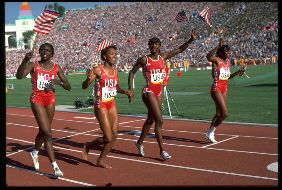11 AUG 1984:  THE 4x400 METRES RELAY TEAM OF THE UNITED STATES CELEBRATE AFTER CLAIMING THE GOLD MEDAL AT THE 1984 LOS ANGELES OLYMPICS. THEY ARE LILLIE LEATHERWOOD , SHERRI HOWARD , VALERIE BRISCO-HOOKS AND CHANDRA CHEESEBOROUGH.