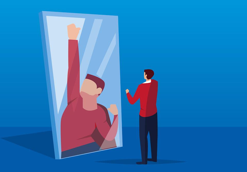 Businessman looks in the mirror (Photo: z_wei via Getty Images)
