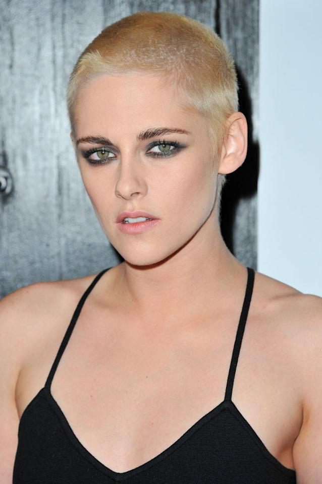 <p>Stewart made a huge splash to promote her latest film, <em>Personal Shopper</em>, in Los Angeles, with a platinum-blond buzz cut. She accentuated her new 'do with bold brows and smoky eye makeup. (Photo: Allen Berezovsky/Getty Images for Fashion Media) </p>
