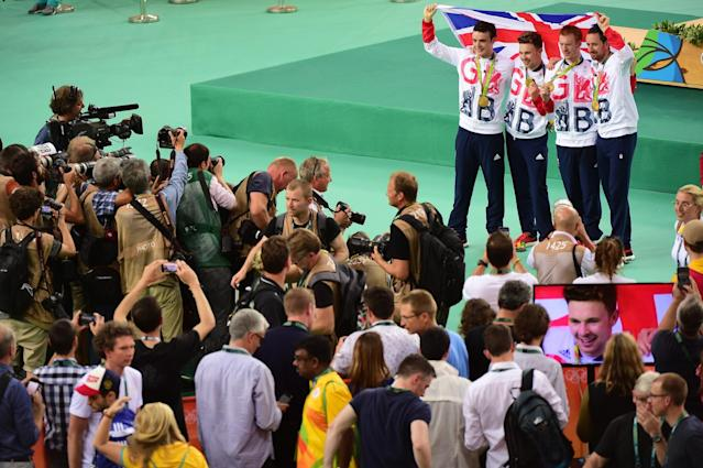 <p>Gold medalists Steven Burke, Owain Doull, Edward Clancy and Bradley Wiggins of Team Great Britain pose for photographs after the medal ceremony for the Men's Team Pursuit on Day 7 of the Rio 2016 Olympic Games at the Rio Olympic Velodrome on August 12, 2016 in Rio de Janeiro, Brazil. (Photo by Harry How/Getty Images) </p>