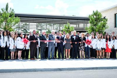 Flanked by medical students, PCOM President and CEO Jay Feldstein, DO, and Georgia Governor Brian Kemp with First Lady Marty Kemp and PCOM Board Chair John Kearney, lead the ribbon cutting which marks the opening of PCOM South Georgia, the first four year medical school in Southwest Georgia.