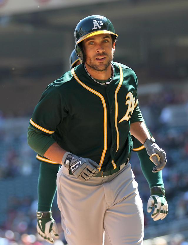 Oakland Athletics left fielder Sam Fuld runs back to the dugout after hitting a home run against the Minnesota Twins in the fourth inning of a baseball game on Thursday, April 10, 2014 in Minneapolis.(AP Photo/Andy Clayton-King)