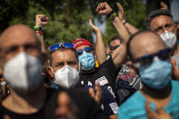 Nissan workers react during a protest outside their factory in Barcelona, Spain, Thursday, May 28, 2020. Japanese carmaker Nissan Motor Co. has decided to close its manufacturing plans in the northeastern Catalonia region, resulting in the loss of some 3,000 direct jobs. (AP Photo/Emilio Morenatti)