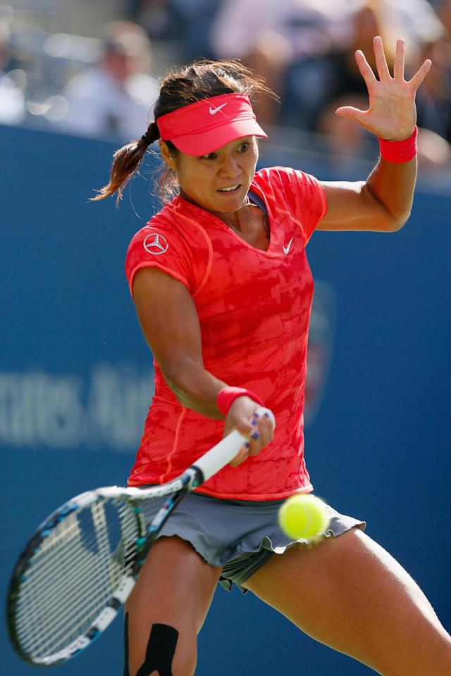 NEW YORK, NY - SEPTEMBER 03: Na Li of China plays a forehand during her women's singles quarterfinal match against Ekaterina Makarova of Russia on on Day Nine of the 2013 US Open at the USTA Billie Jean King National Tennis Center on September 3, 2013 in New York City. (Photo by Mike Stobe/Getty Images for the USTA)