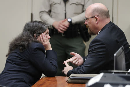 Attorney Jeff Moore speaks with Louise Turpin as she and David Turpin (not pictured) appear in court in Riverside, California, U.S., February 23, 2018. REUTERS/Gina Ferazzi/Pool