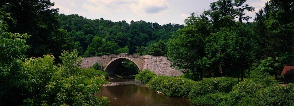 """<p><strong>The Drive: </strong><a href=""""http://www.visitmaryland.org/scenic-byways/historic-national-road"""" rel=""""nofollow noopener"""" target=""""_blank"""" data-ylk=""""slk:Historic National Road"""" class=""""link rapid-noclick-resp"""">Historic National Road</a></p><p><strong>The Scene: </strong> Starting in <a href=""""https://www.tripadvisor.com/Tourism-g60811-Baltimore_Maryland-Vacations.html"""" rel=""""nofollow noopener"""" target=""""_blank"""" data-ylk=""""slk:Baltimore"""" class=""""link rapid-noclick-resp"""">Baltimore</a>, the <a href=""""https://www.tripadvisor.com/ShowTopic-g41098-i2154-k5651234-Maryland_Historic_National_Road-Cumberland_Maryland.html"""" rel=""""nofollow noopener"""" target=""""_blank"""" data-ylk=""""slk:Historic National Road"""" class=""""link rapid-noclick-resp"""">Historic National Road</a> runs through several other states; the diverse route ranges from urban landscapes to country scenes with the Western Maryland mountains as a backdrop.</p><p><strong>The Pit-Stop: </strong>If you want to experience the route by train, climb aboard for a short ride on the <a href=""""https://www.tripadvisor.com/Attraction_Review-g41098-d103345-Reviews-Western_Maryland_Scenic_Railroad-Cumberland_Maryland.html"""" rel=""""nofollow noopener"""" target=""""_blank"""" data-ylk=""""slk:Western Maryland Scenic Railroad"""" class=""""link rapid-noclick-resp"""">Western Maryland Scenic Railroad</a>. </p>"""