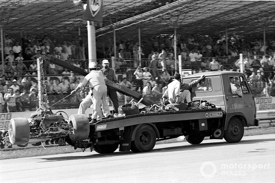 """The wreckage of Jochen Rindt's Lotus 72 is carried away after his fatal accident <span class=""""copyright"""">David Phipps</span>"""
