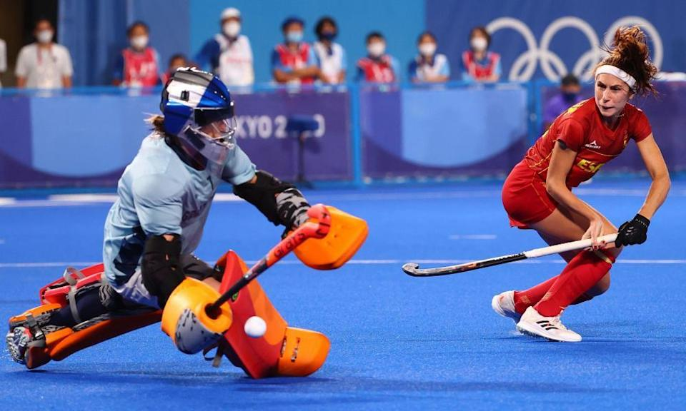 Maddie Hinch of Britain saves a shot by Begona Garcia of Spain during their shootout.
