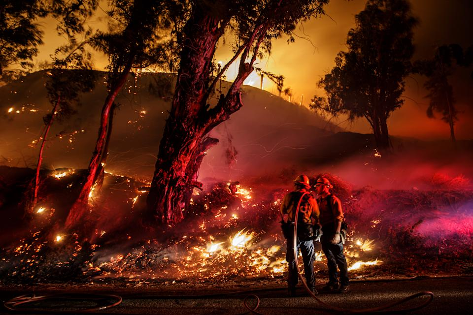 SANTA PAULA, CALIF. -- FRIDAY, NOVEMBER 1, 2019: Firefighters monitor a back burn as they work to control the spread of the Maria Fire in Santa Paula, Calif., on Nov. 1, 2019. (Photo by Marcus Yam/Los Angeles Times via Getty Images)