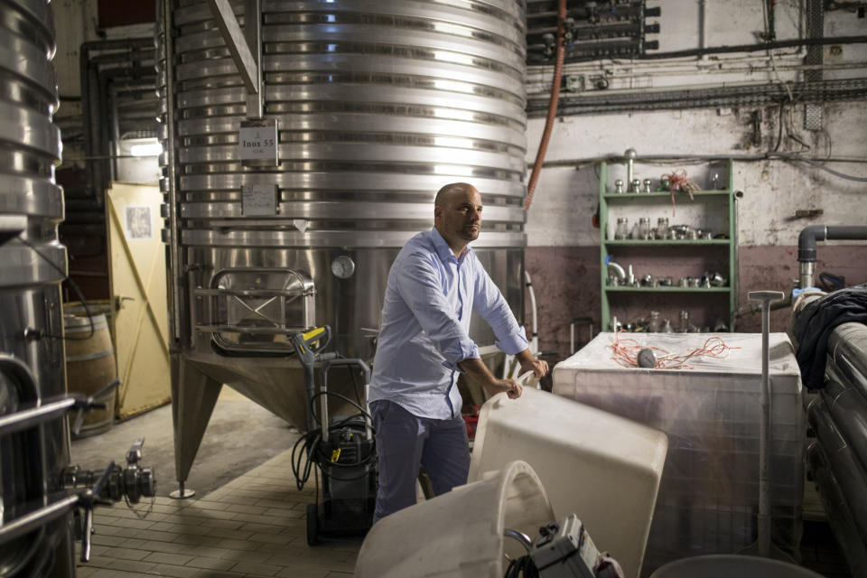 Sebastien Latz, director general of the French wine producer MDCV, poses in a wine production facility in the Chateau des Bertrands vineyard in Le Cannet-des-Maures, in the Provence region, Thursday Oct. 10, 2019. European producers of premium specialty agricultural products like French wine, Italian Parmesan and Spanish olives are facing Friday's U.S. tariff hike with a mix of trepidation and indignation at being dragged into a trade war over the fiercely competitive aerospace industry. (AP Photo/Daniel Cole)