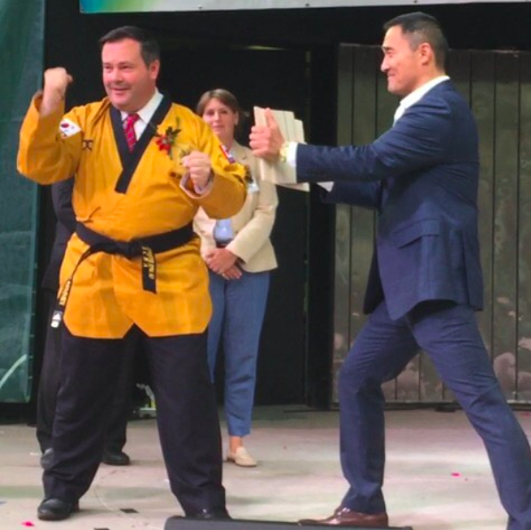 <p>Alberta United Conservative leader Jason Kenney, left, wears a Tae Kwan Do robe and an honourary black belt during Toronto's Korean Harvest Moon Festival in August 2015. Photo from Jason Kenney/Twitter. </p>