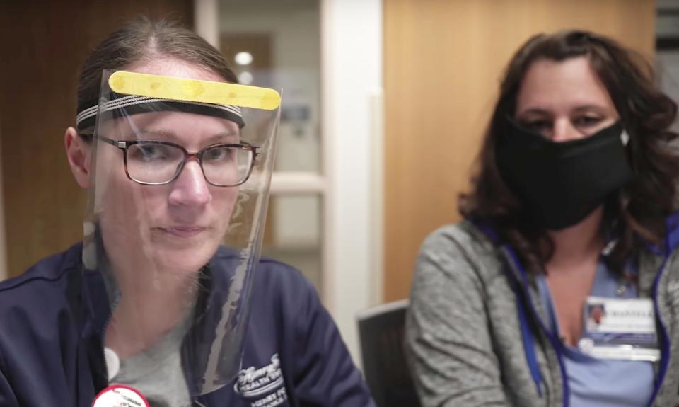 """Two health care employees show homemade masks in a YouTube video titled """"DIY Mask for Coronavirus."""" (Source: screenshot/YouTube/Henry Ford)"""