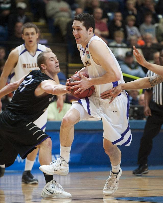 Williams College's Daniel Wohl (5) drives against Wisconsin-Whitewater's Eric Bryson during the first half of an NCAA Division III college basketball championship game at the Salem Civic Center, Saturday, March 22, 2014, in Salem, Va. (AP Photo/Don Petersen)