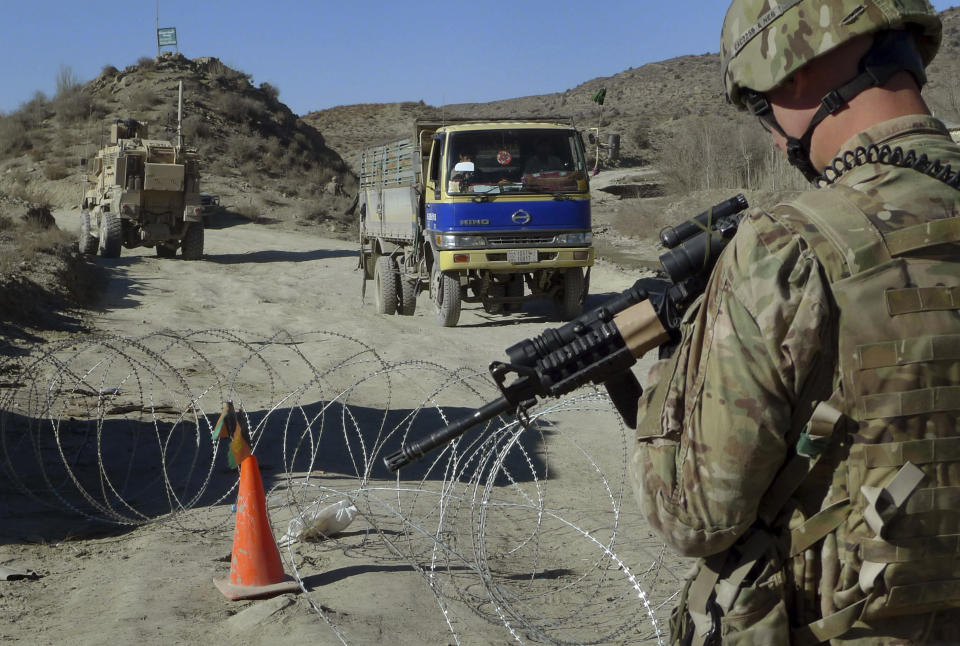 FILE - In this Dec. 1, 2011, file photo, a U.S. soldier with Apache Company of Task Force 3-66 Armor, out of Grafenwoehr, Germany, stands guard at a police checkpoint at Gulruddin pass in Sar Hawza district of Paktika province, south of Kabul, Afghanistan. A significant majority of Americans are skeptical that the war in Afghanistan was worthwhile even as they are more divided over the president's handling of foreign policy and national security, according to a new poll from The Associated Press-NORC Center for Public Affairs Research. (AP Photo/Heidi Vogt, File)