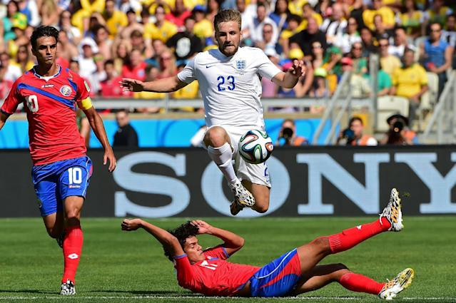 England full-back Luke Shaw (top) in action during a World Cup Group D match against Costa Rica at the Mineirao Stadium in Belo Horizonte, on June 24, 2014 (AFP Photo/Ronaldo Schemidt)